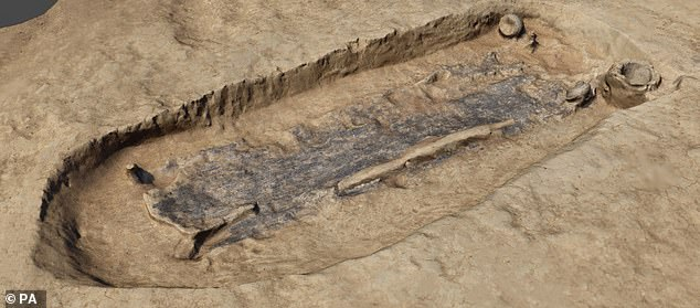 The grave of the warrior contained a sheathed sword and a spear as well as the remains of a wooden container, preserved as a dark stain, probably used to lower the individual into the grave (pictured)