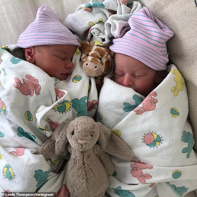 Sibling love: Bo and Sam can also be seen sleeping side-by-side, wrapped in blankets with blue and pink beanie caps on their heads to help keep them warm