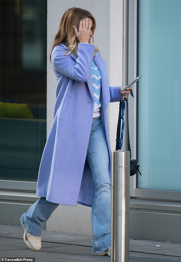 Finishing touches:The presenter added to her look with a wool lilac winter coat, while chunky trainers rounded things off