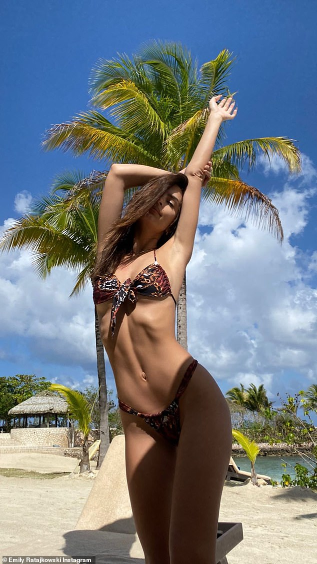 Sultry: Emily looked sexy as she modeled her own Inamorata swimsuit during a vacation to Jamaica
