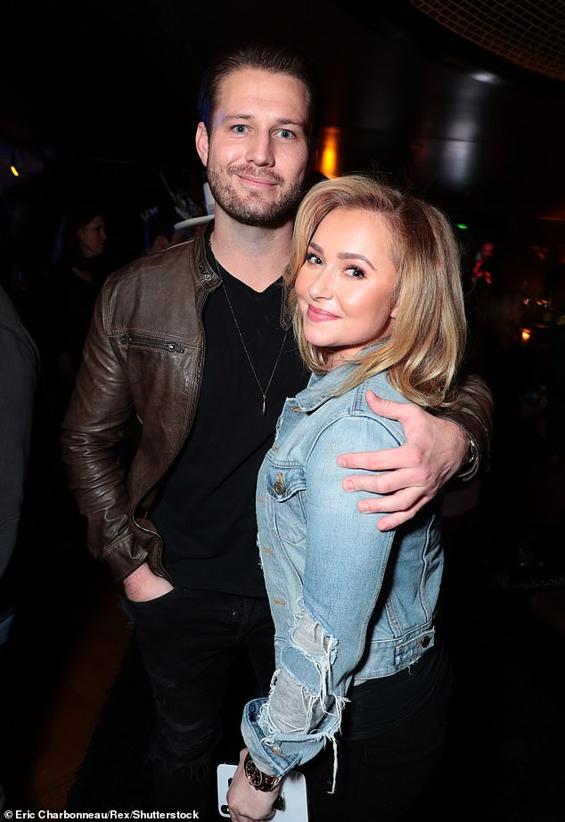 Happier times:Brian was arrested on Friday around 2:30am after allegedly punching her face with a closed fist during a fight on Valentine's Day; pictured December 1, 2018 in LA
