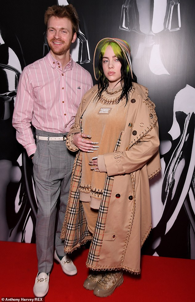 In good company: Billie was joined by older brother and songwriting partner Finneas O'Connell