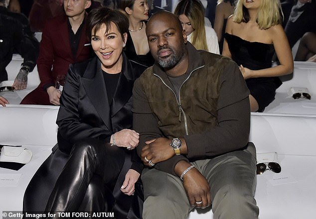 Settling in: Kris gives a big smile as she snuggles up next to Corey before the ladies take the runway