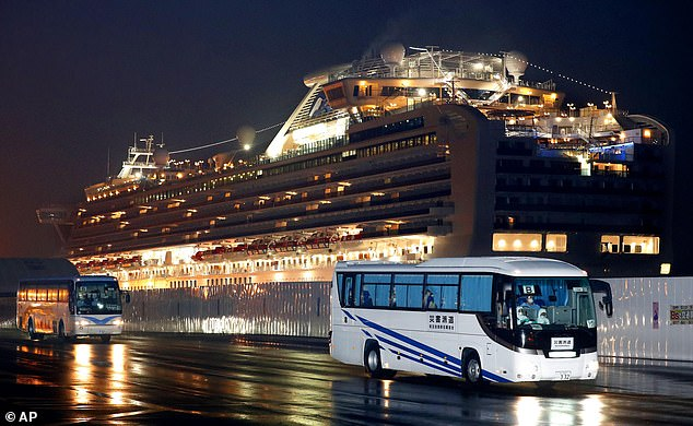So far, 542 people on the ship have tested positive for coronavirus, 14 of whom were Americans. Pictured: Buses carrying US passengers who were aboard the quarantined cruise leaves Yokohama port