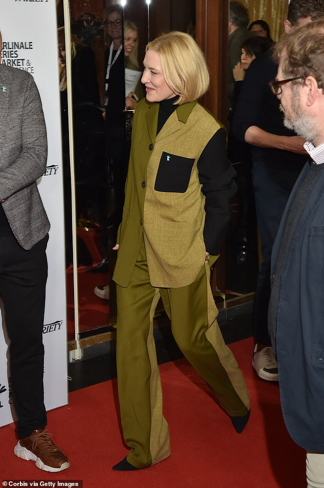 Gorgeous: The Oscar winner kept her blonde tresses styled into a sleek bob as she arrived in the classic green suit