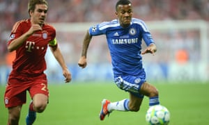 Philipp Lahm (left) battles for the ball with Ryan Bertrand (right).