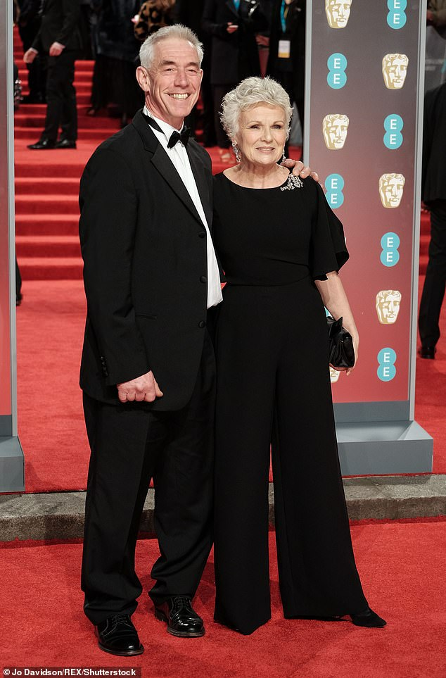 Marriage: She remembers telling her husband Grant Roffey. 'I'll never forget his face,' Dame Julie said (pictured in February 2018)