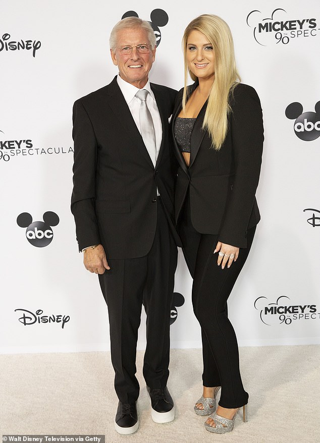 Talented: The former music teacher considers his daughter to be 'a very talented songwriter who will go from strength to strength' as her career progresses; the pair were pictured together at the premiere ofMickey's 90th Spectacular in 2018