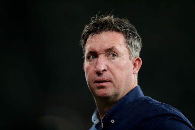 Liverpool legend Robbie Fowler looks on during the round 13 A-League match between the Western Sydney Wanderers and the Brisbane Roar