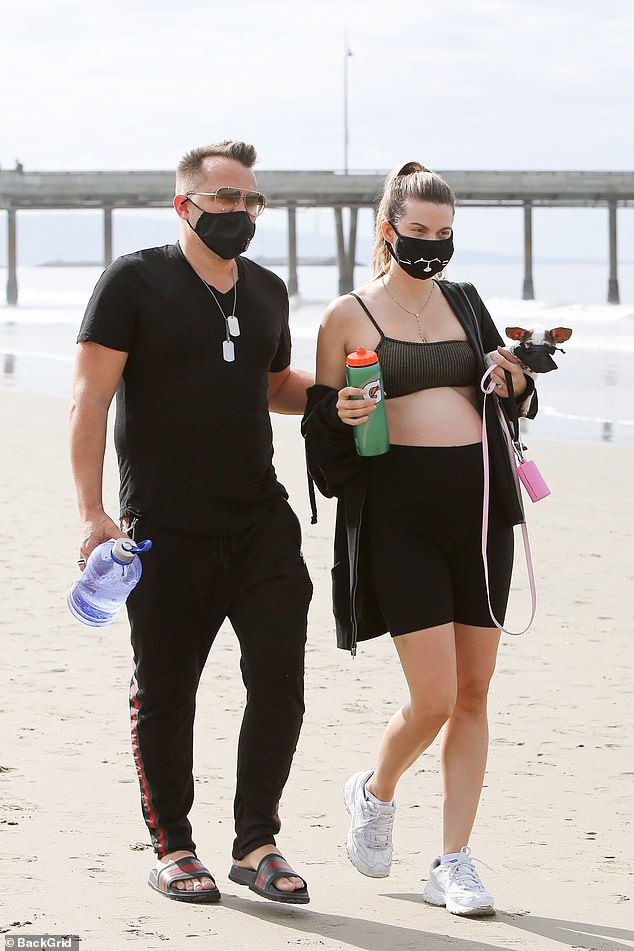Out and about: Rachel McCord was determined to get some fresh air on Sunday, braving the coronavirus pandemic to visit the beach in Los Angeles with her husband Rick Schirmer