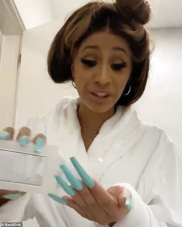 Rubbing alcohol? Rapper Cardi B admitted she was 'a little scared' and 'overwhelmed with everything that's going on around the world' (posted Thursday)
