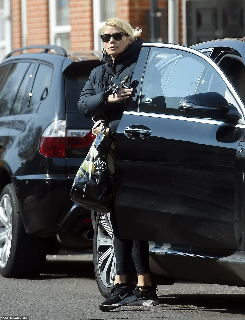 Chilled: While the TV star swept her blonde tresses into a bun and shielded her eyes with dark sunglasses