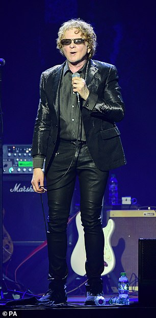 Sharp: Mick made sure he was dressed to impress for the event, as he donned a sequinned blazer over a sleek black shirt