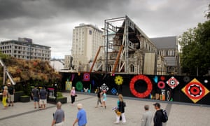 Pedestrians walk past the remains of the Christchurch Cathedral
