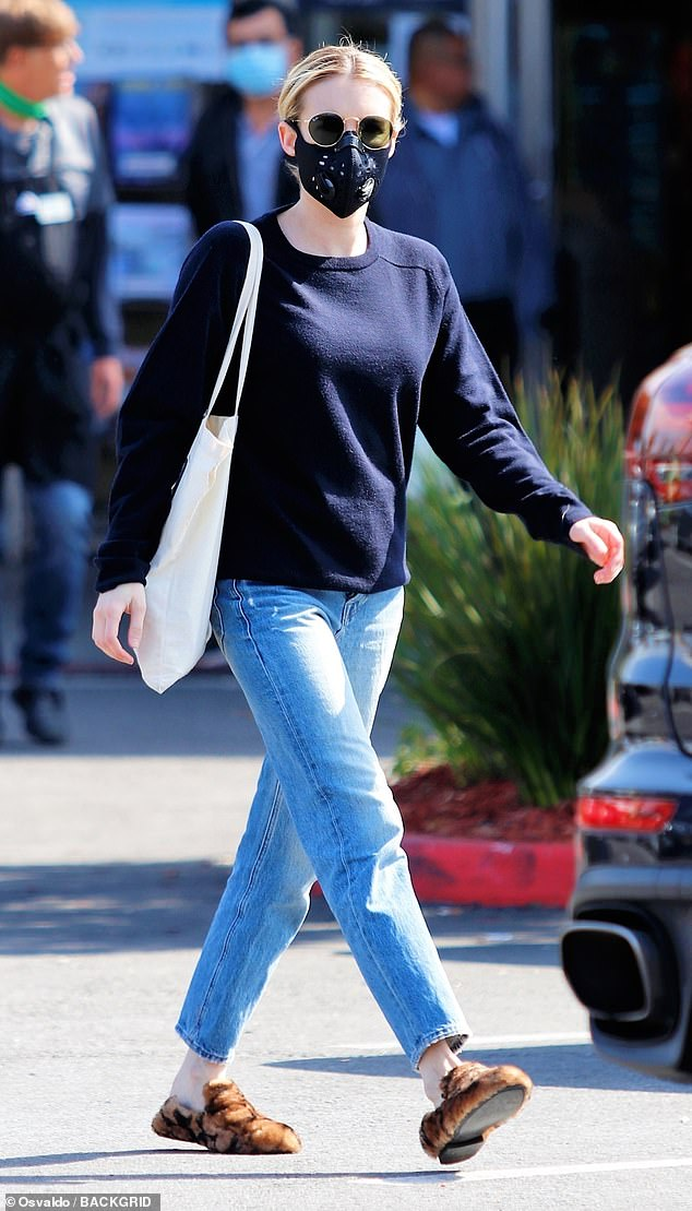 Incognito: Emma Roberts was nearly unrecognizable when she went to pick up some groceries wearing a protective mask and dark sunglasses in Los Angeles on Saturday