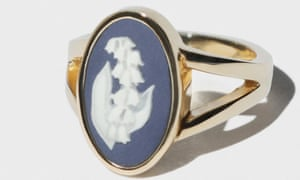 Gold ring with blue and white stone