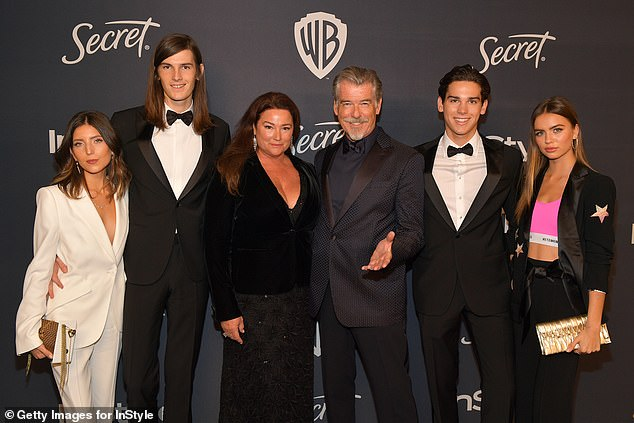Family: Avery Wheless, son Dylan, Keely, Pierce , son Paris and Alex Lee (L-R) pictured in January at the Golden Globes