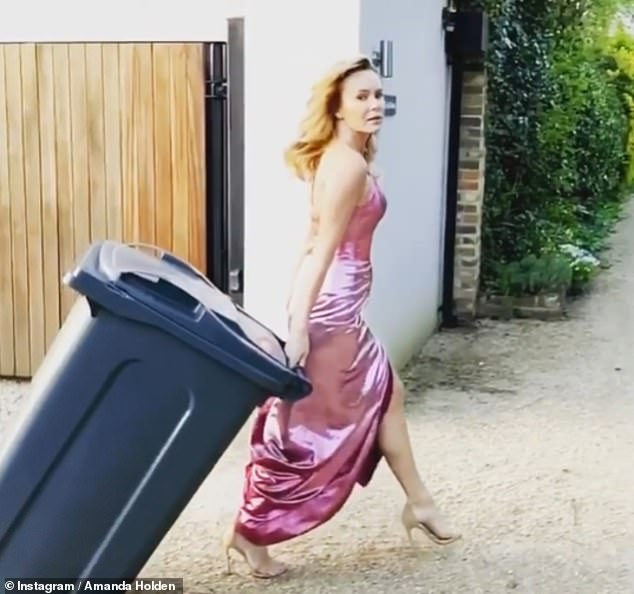 Wow-factor! Earlier in the week, Amanda took things further when she wheeled her bin out while wearing a shimmering evening gown