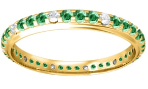 Gold eternity ring with green and a few transparent stones