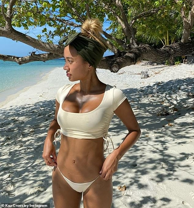 Stunning scenes: The reality TV starlet has been documenting her sunny beach getaway, and recently shared another sexy snap of her figure clad in a cream bikini