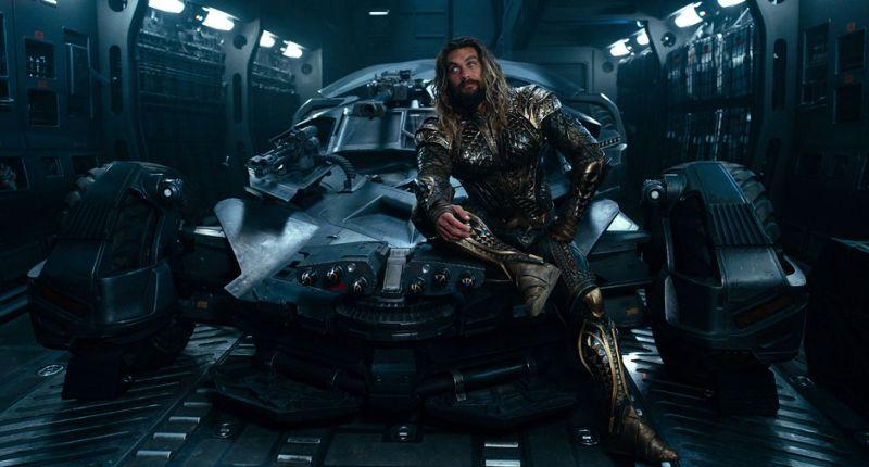 Jason Momoa sits atop the Batmobile in 'Justice League' (Warner Bros.)