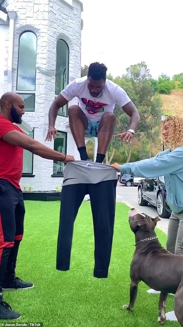 Leap:The Wiggle singer took to his TikTok on Monday, sharing a slow-motion video of a man and a woman holding a pair of stretch pants as Derulo takes a running start and shows off quite the impressive vertical leap by actually jumping into the pants