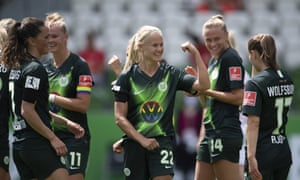 Pernille Harder celebrates her opening penalty.