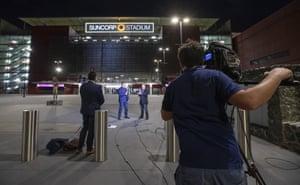 TV crews operate outside Suncorp Stadium