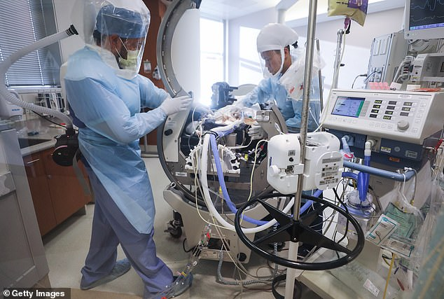 Abbott's test has been used to diagnose White House staffers that have worked closely with President Trump and Vice President Pence. Pictured: Nurses Albert Legayada (left) and Fred Bueno care for a COVID-19 patient in the ICU at Sharp Grossmont Hospital in La Mesa, California, May 6