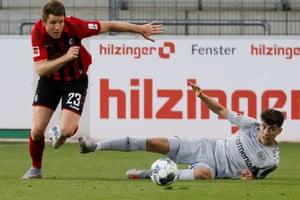 Bayer Leverkusen's Kai Havertz (right) comes out second best in this challenge with Freiburg's Dominique Heintz