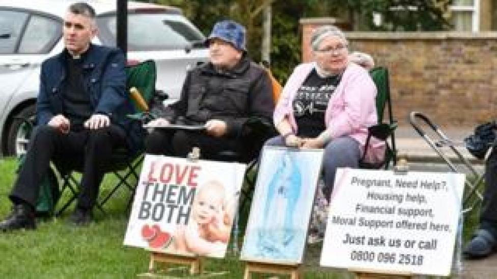 Anti-abortion campaigners outside clinic
