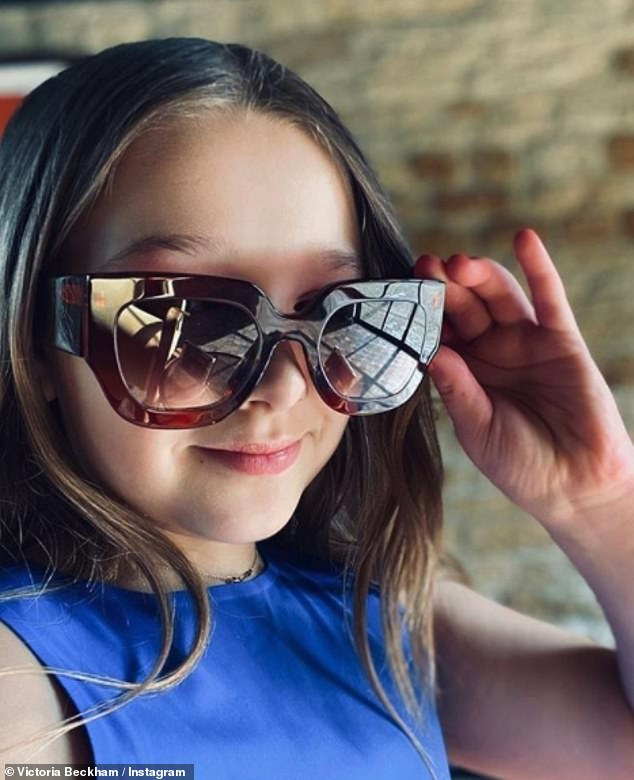 Adorable: Victoria revealed that her daughter, Harper, eight, is also getting back into the spirit as she posed in a pair of her mother's oversized sunglasses on Saturday