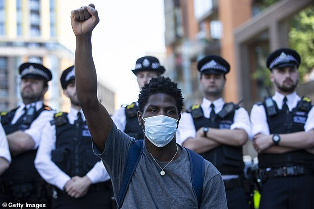 Powerful: Chants of, 'I can't breathe,' rebounded across the Thames in London on Sunday (pictured) - the words George was heard gasping before his passing