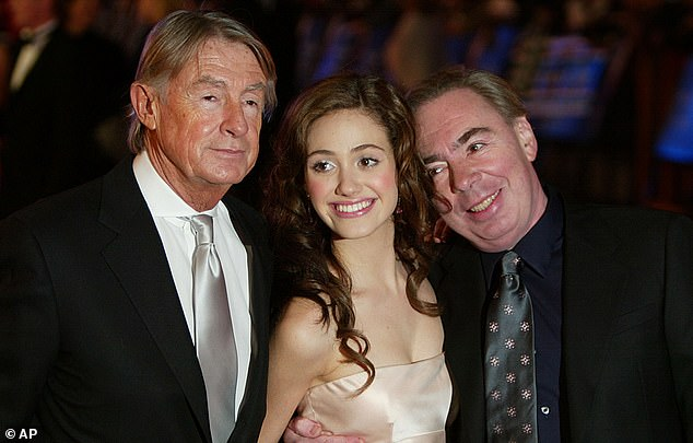 'He shaped my life': Emmy Rossum poses with Joel Schumacher (left) and Andrew Lloyd-Webber at the 2004 premier of The Phantom of the Opera in Leicester Square, London