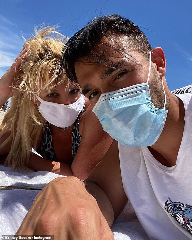 Beach day:The loved up pair took a break from lockdown on Monday to enjoy a day at the beach