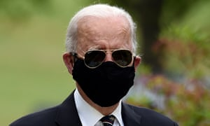 US Democratic presidential candidate Joe Biden wearing a black face mask on Memorial Day in May