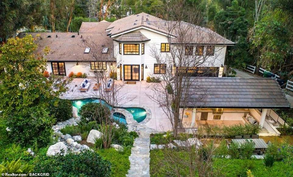 Big purchase: Miley Cyrus has splashed out $4.95 million for a six-bedroom home on one and a quarter acres in the luxury enclave, Variety reported Thursday
