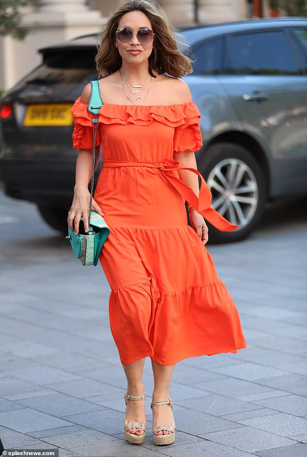 Stylish: Myleene Klass looked her stylish best as she arrived to work at Smooth Radio on Sunday