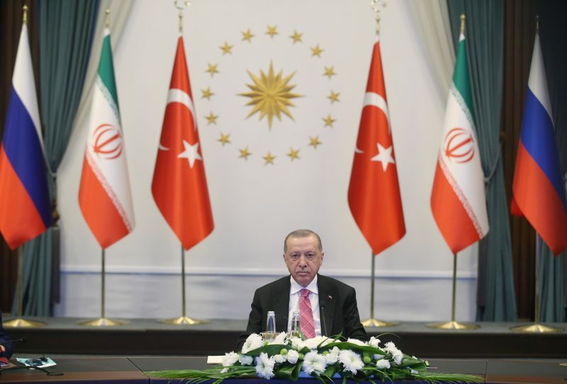 © Reuters. Turkish President Erdogan attends a video conference call with Russia's President Putin and Iran's President Rouhani in Ankara