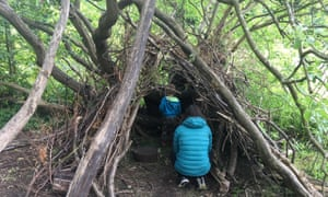 Lucie Tisdale, her partner, and her son, explore a house made of twigs