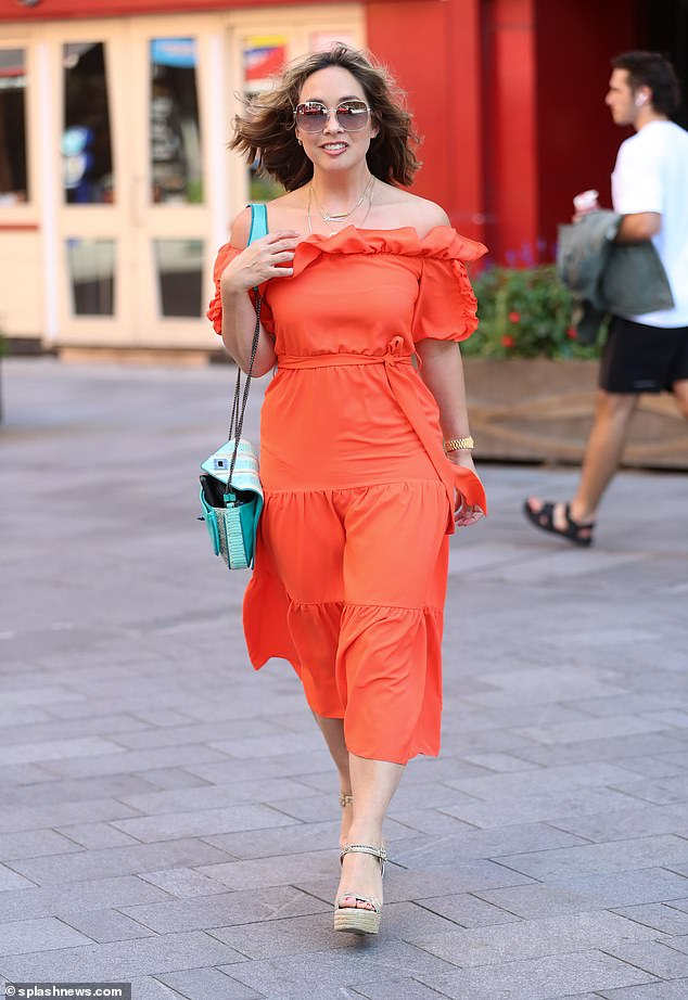 Fashionista: The presenter, 42, was the picture of summer in a flowing orange dress for her commute