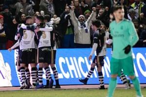 Unionistas players celebrate scoring against Madrid.
