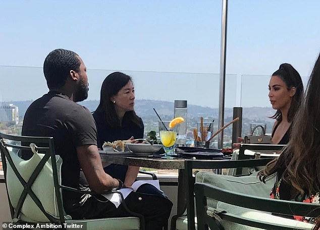 Proof: Kanye had appeared to suggest the meeting was just a ruse but this picture shows the group engaged in conversation over lunch