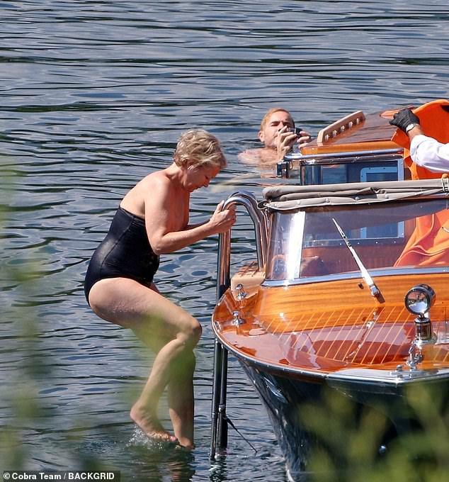 Stunning:Dawn looked sensational in a black bandeau swimsuit as she was seen getting into the water after her husband had jumped from the boat into the cool waters
