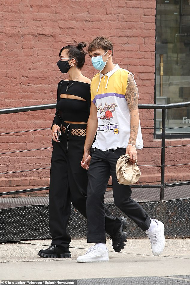Lunch date:The couple appeared in good spirits as they happily walked hand in hand from lunch at the eatery