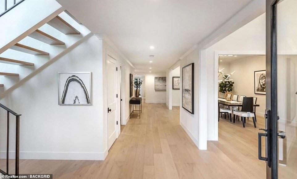 Open plan: The formal dining room is located off the entrance and a wide staircase leads to the upper level
