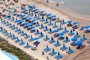 A view of the Poniente beach mostly empty of people during a sunny day in Benidorm, eastern Spain, on 29 July 2020.