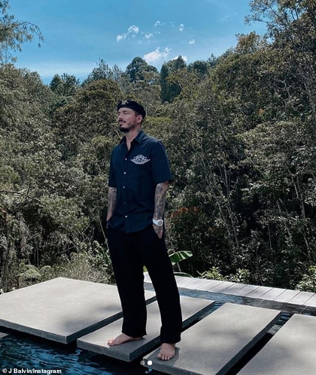 Still infected? Two-time Grammy nominee J Balvin revealed Thursday that he is 'just getting better' from 'bad' case of the deadly coronavirus (pictured Wednesday)