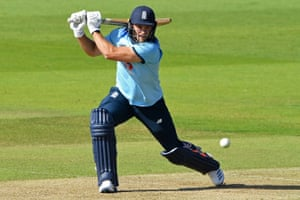 England's David Willey plays a shot for four.