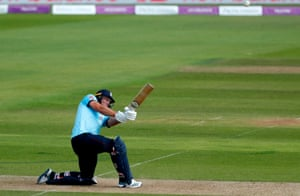 England's David Willey hits a six.